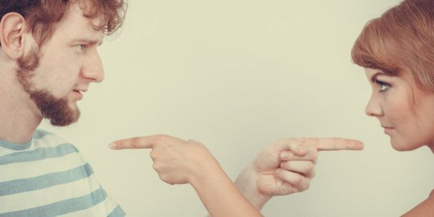 Conflict bad relationships concept. Two people couple pointing fingers at each