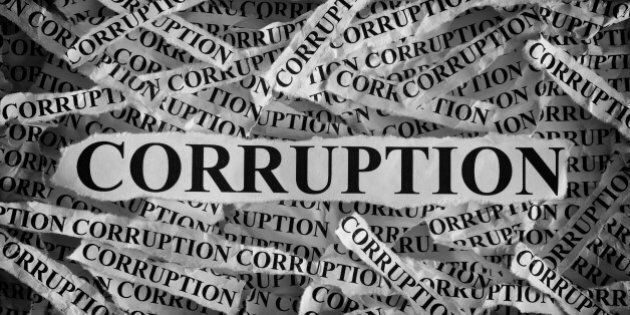 Torn pieces of paper with the word Corruption. Concept Image. Black and White.