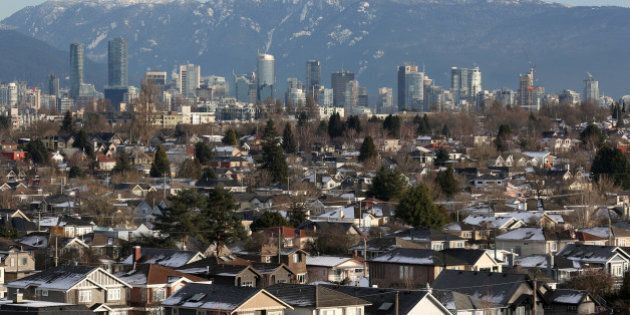 Rooftops of houses in the Kitsilano neighbourhood and the downtown core are seen in Vancouver, British...
