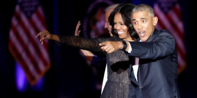 U.S. President Barack Obama and his wife Michelle acknowledge the crowd after President Obama delivered...