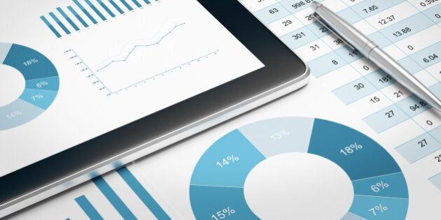 digital tablet and financial report on