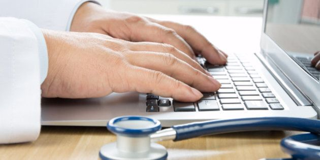 Close up of doctor's hand at computer