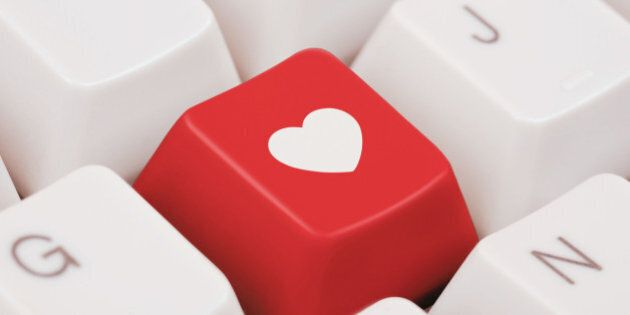 Red computer key with heart