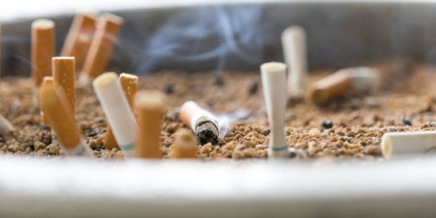 cigarette butts on focus of macro in sand