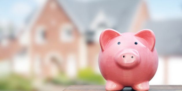Saving to buy a house, real estate or home savings, piggy bank in front of