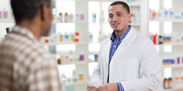 A senior man getting a prescription filled