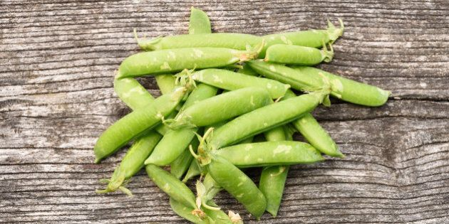 Fresh peas on a wooden