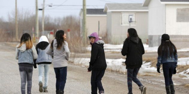 Girls walk on a street in the Attawapiskat First Nation in northern Ontario, Canada, April 14, 2016. REUTERS/Chris Wattie