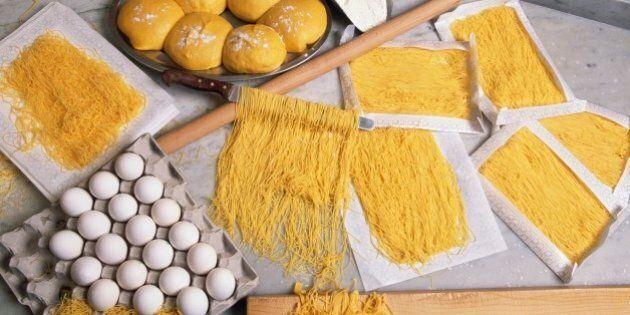 ITALY - MARCH 24: Preparing spinosini, fine egg pasta, Spinosi pasta factory, Campofilone, Marche, Italy....