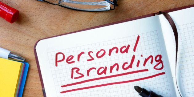 Notepad with  Personal Branding on office wooden table.