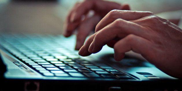 Women is writing on laptop
