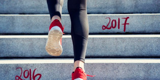 Female Runner jumping into the new Year 2017 and leaving 2016 behind.
