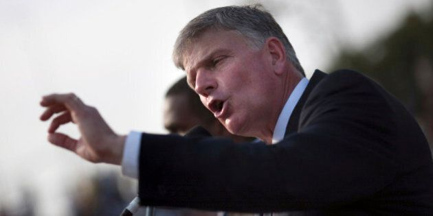 Franklin Graham, son of evangelist Billy Graham, addresses the crowd at the Festival of Hope, an evangelistic rally held at the national stadium in Port-au-Prince, January 9, 2011. REUTERS/Allison Shelley (HAITI - Tags: DISASTER ENVIRONMENT RELIGION)
