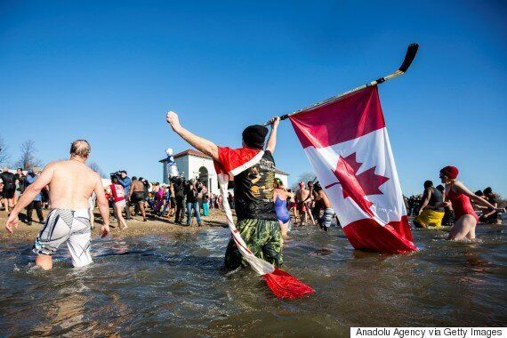 Polar Bear Swimmers Kick Off New Year With Frosty