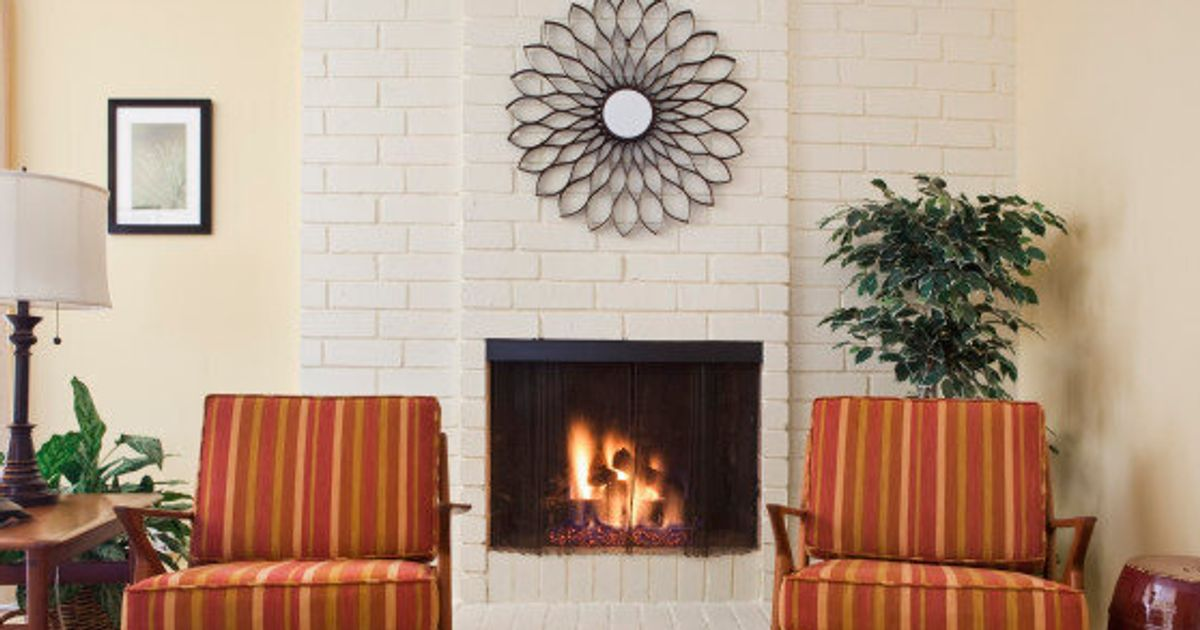 How To Hang Art Above A Fireplace