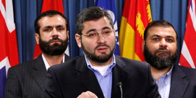Abdullah Almalki (C), with Muayyed Nureddin (L) and Ahmad El Maati, speaks during a news conference on...