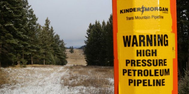 A sign warning of the subterranean presence of Kinder Morgan's Trans Mountain Pipeline in seen in ranchland...