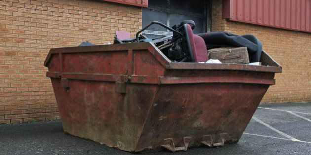 Rusty old skip full of office rubbish or Garbage