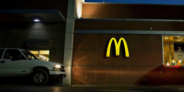 Vehicles move through the drive-thru of a McDonald's Corp. restaurant in Peru, Illinois, U.S., on Monday, July 20, 2015. McDonald's Corp. is scheduled to report quarterly earnings on July 23. Photographer: Daniel Acker/Bloomberg via Getty Images