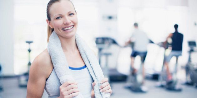 Portrait of smiling woman in gymnasium