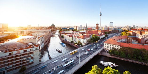 Cityscape from the east side of berlin with sunset.Traffic on a big city and ships on the river spree.