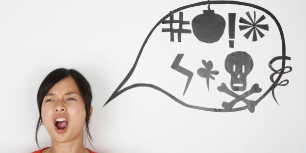 Woman shouting with speaking bubble signs on wall