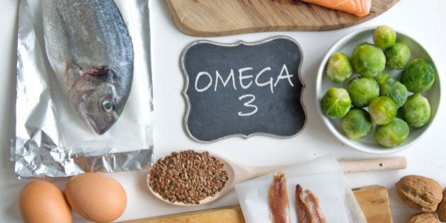 Collection of foods high in fatty acids omega 3 including seafood, vegetables and
