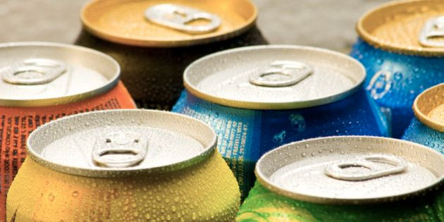 Cans of soft drink. Cooling frozen and with water