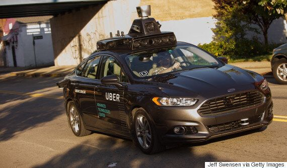 Driverless Uber Car Runs Red Light On First