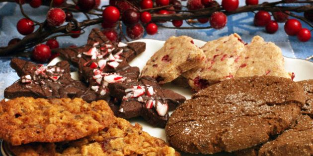 **FOR USE WITH AP LIFESTYLES** **FILE**  This Nov. 20, 2006 file photo shows, from left, Chewy Cranberry-Oatmeal Cookies, Chocolate Peppermint Stars, Cranberry-Orange Shortbread Cut-Outs and Giant Ginger Cookies.  Holidays are often associated with parties, goodies and the inevitable weight gain.     (AP Photo/Larry Crowe, FILE)