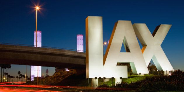 USA, California, Los Angeles, Road to International Los Angeles Airport, illuminated LAX