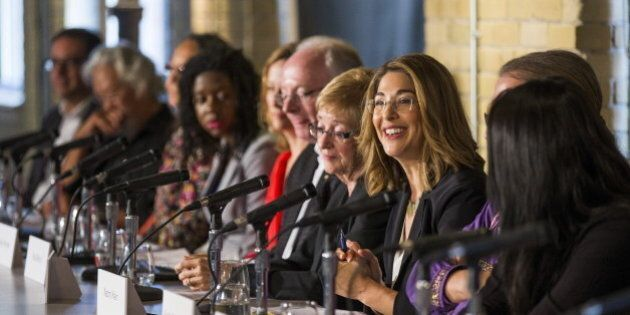 Author Naomi Klein (3rd R) speaks during a news conference to launch