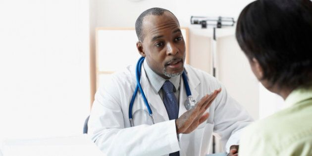 African male doctor talking to