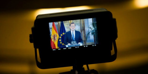 Spain's acting Prime Minister and Popular Party leader Mariano Rajoy is shown in a tv camera screen as...