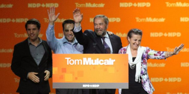 Canada's New Democratic Party (NDP) leader Tom Mulcair waves with his wife Catherine and sons Greg (L)...