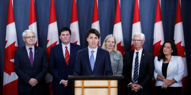 Canada's Prime Minister Justin Trudeau (3rd L) speaks during a news conference with Transport Minister...