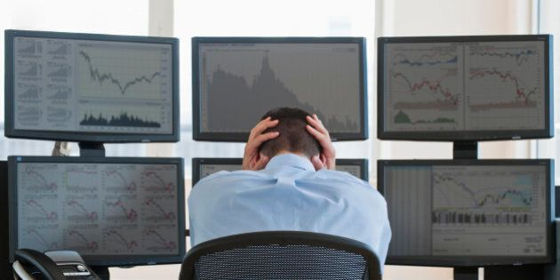 Frustrated male trader at