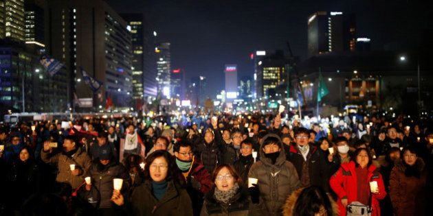 People attend a protest calling for South Korean President Park Geun-hye to step down in central Seoul, South Korea, November 30, 2016.  REUTERS/Kim Hong-Ji     TPX IMAGES OF THE DAY