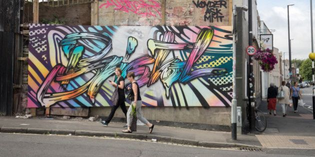 BRISTOL, ENGLAND - JULY 27: People walk past artwork produced as part of the 2016 Upfest on July 27,...