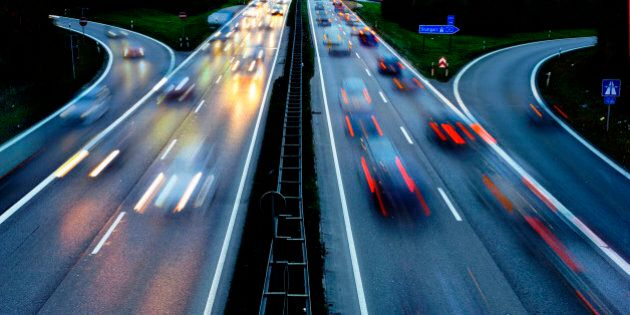 cars on Autobahn highway in Germany in high speed at