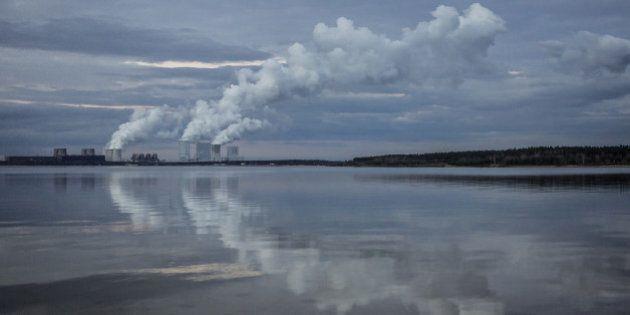 KLITTEN, GERMANY - FEBRUARY 14: Boxberg Power Station is reflected in the lake 'Baerwalder See' in Klitten...