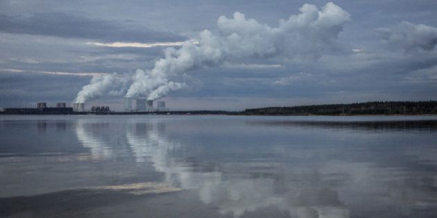 KLITTEN, GERMANY - FEBRUARY 14: Boxberg Power Station is reflected in the lake 'Baerwalder See' in Klitten on February 14, 2016. This lignite-fired power station is the fourth largest in Germany. (Photo by Florian Gaertner/Photothek via Getty Images)