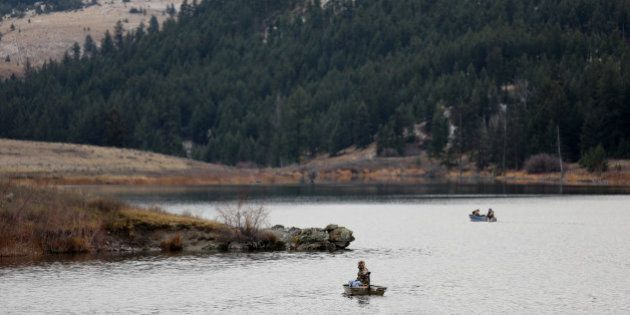 Boaters fish for trout on Jacko Lake, near the site of a proposed expansion of Kinder Morgan's Trans Mountain Pipeline, as well as a proposed Ajax copper mine, in the grasslands on the outskirts of Kamloops, British Columbia, Canada, November 16, 2016.  REUTERS/Chris Helgren