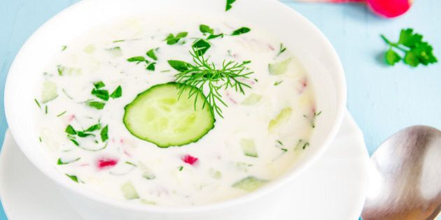Cold soup with yogurt and vegetables and herbs close