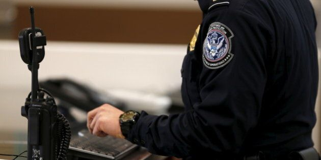 A U.S. Customs and Immigration officer works a new border crossing during the opening day of the Cross...