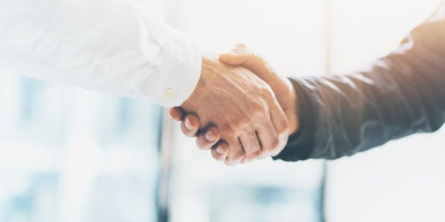 Business partnership meeting. Picture businessmans handshake. Successful businessmen handshaking after...