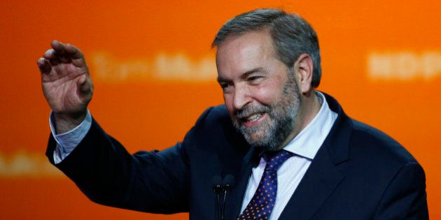 Canada's New Democratic Party (NDP) leader Tom Mulcair waves at the end of his concession speech after...