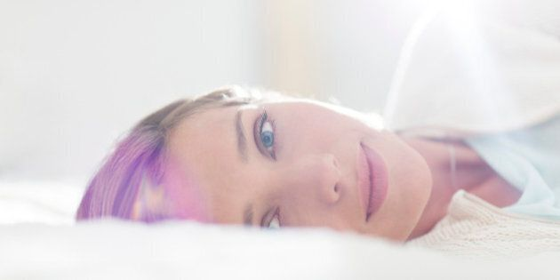 Close up of woman laying on