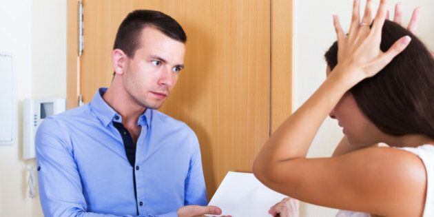 Collector with serious face asking sad householder for money