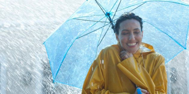 Happy woman under umbrella in